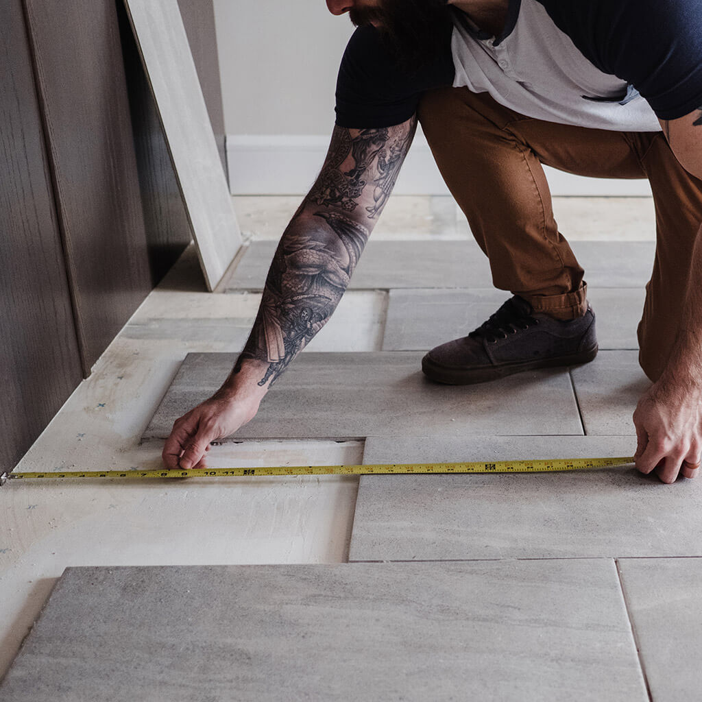 Man measuring floor